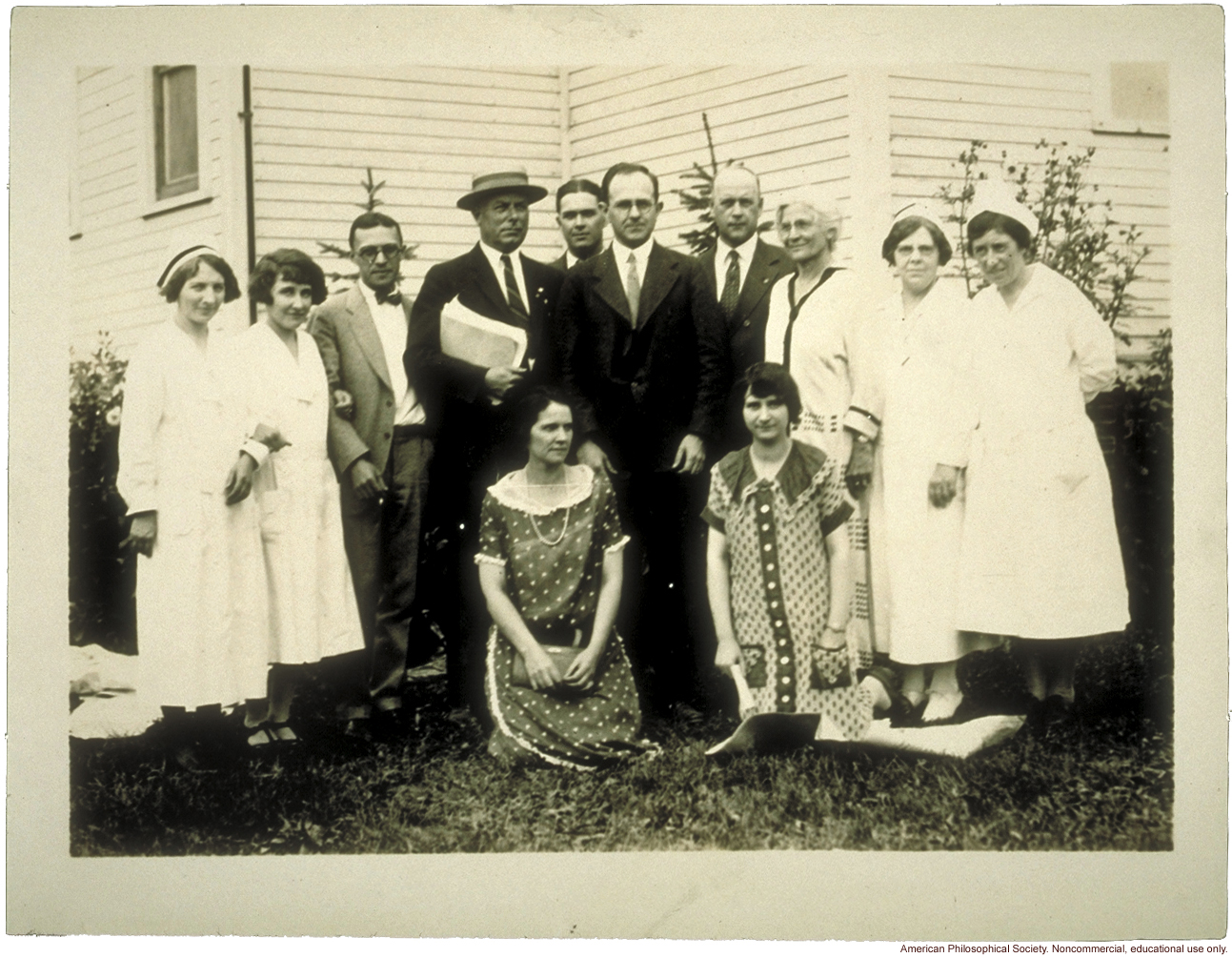 Examining staff for the Fitter Families Contest at Michigan State Fair. Leon F. Whitney (center) and Mary T. Watts (standing, third from right).