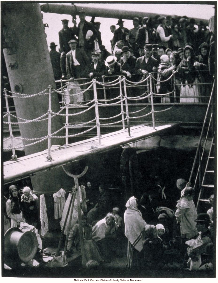 Immigrants in steerage (lower) on board steamship arriving at Ellis Island