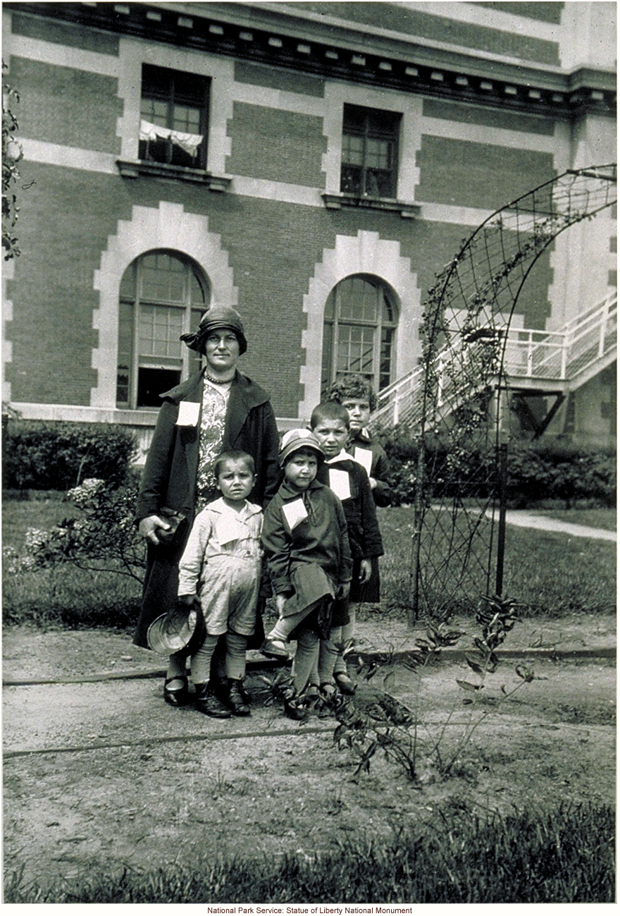Mother and children, with tags, at Ellis Island