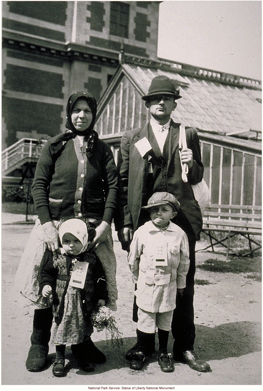 Immigrant family, with tags, at Ellis Island
