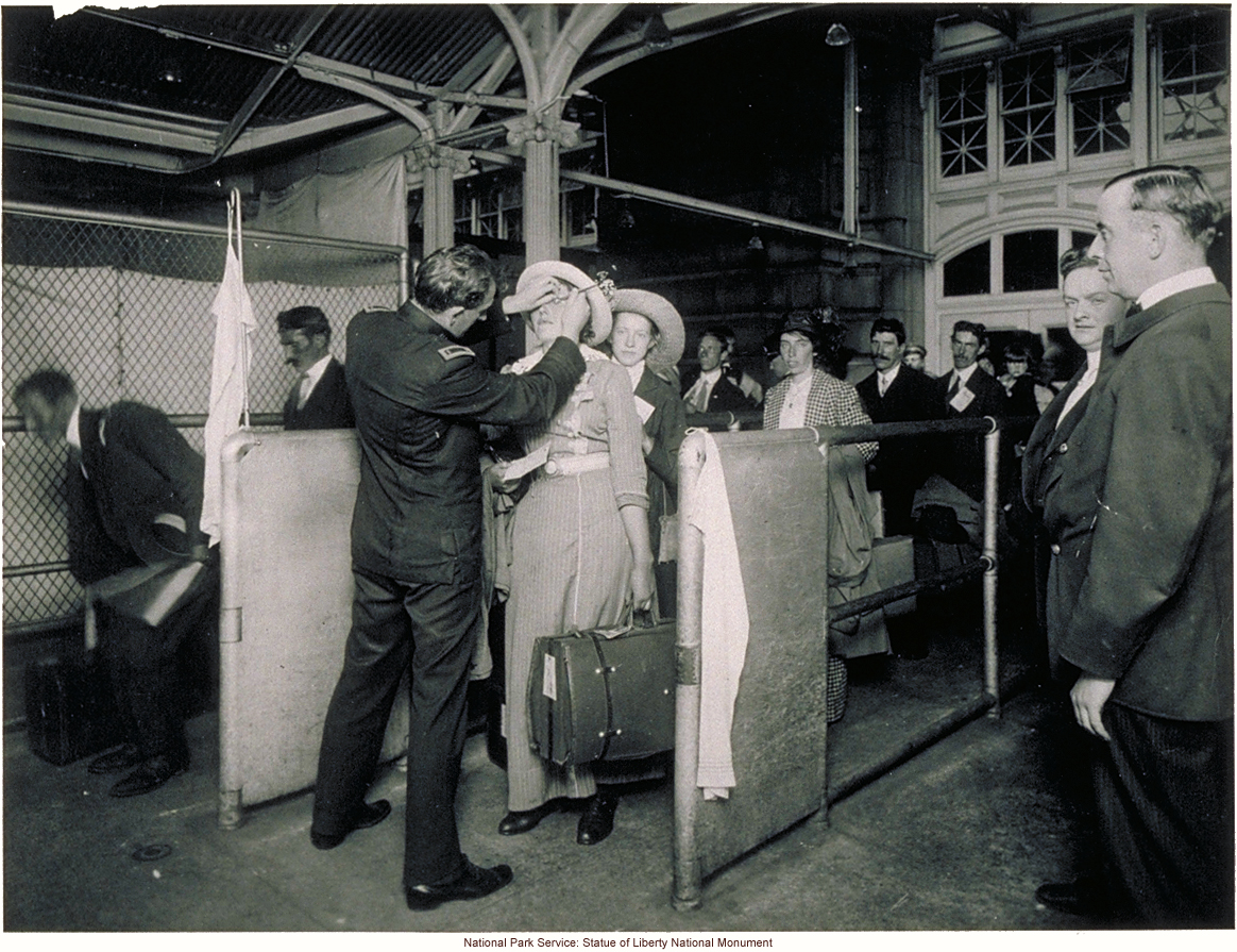 Doctor examining eyes of immigrant woman at Ellis Island