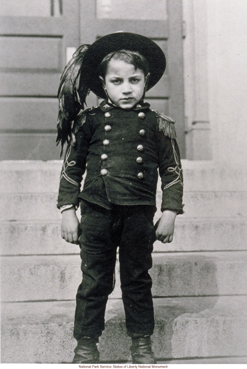 Italian boy at Ellis Island (Photograph by Augustus Sherman)