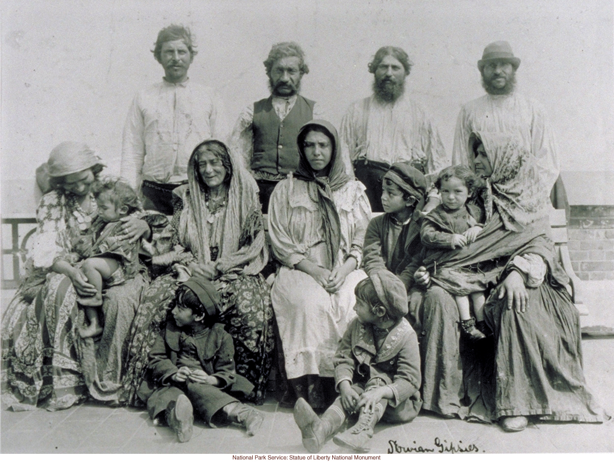 Slovenian Gypsy family at Ellis Island (by Augustus Sherman)