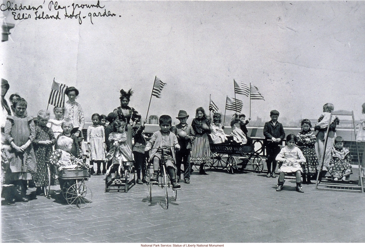 Immigrant children on &quote;roof garden&quote; playground at Ellis Island (Photograph by Augustus Sherman)