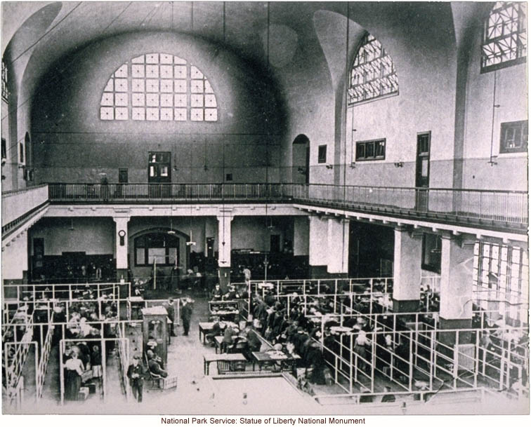 Immigrants being processed in the Great Hall at Ellis Island