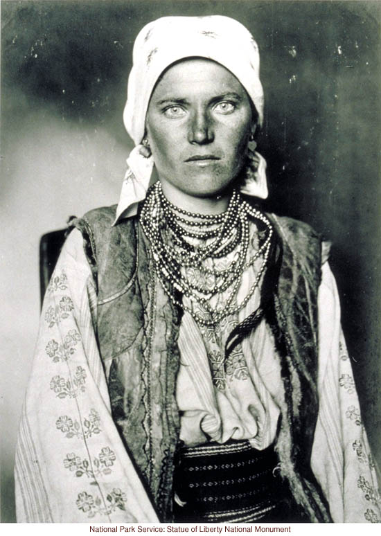 Gypsy woman at Ellis Island (Photograph by Augustus Sherman)
