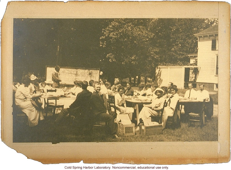 Eugenics Record Office, Field Worker Training Class of 1913 (Laughlin in foreground, center, Davenport at blackboard, Stewart House in background)