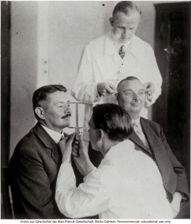 40-year-old male twins undergoing anthropometric study by Otmar Freiherr von Verschuer