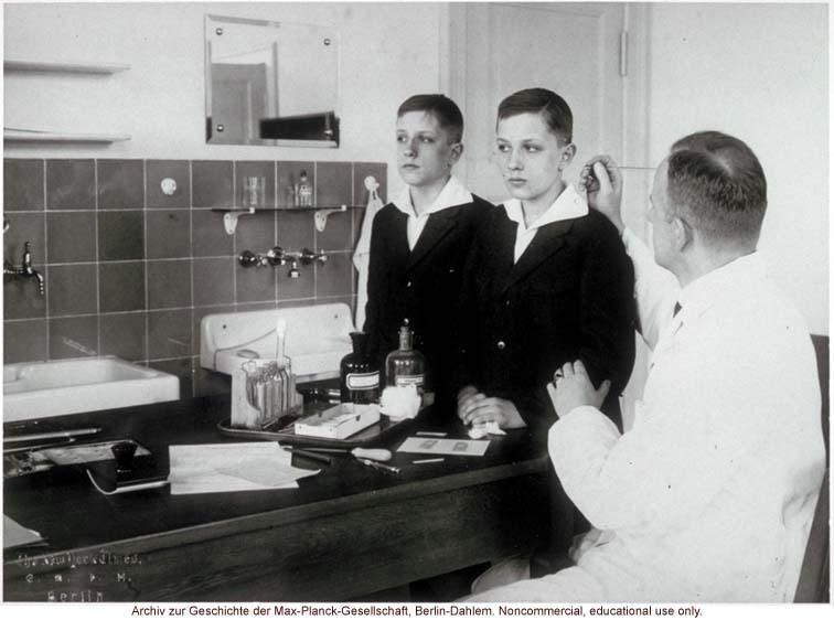 12-year-old male twins undergoing anthropometric study by Otmar Freiherr von Verschuer