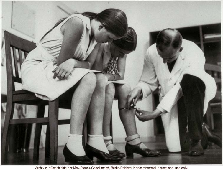16-year-old female twins undergoing anthropometric study by Otmar Freiherr von Verschuer