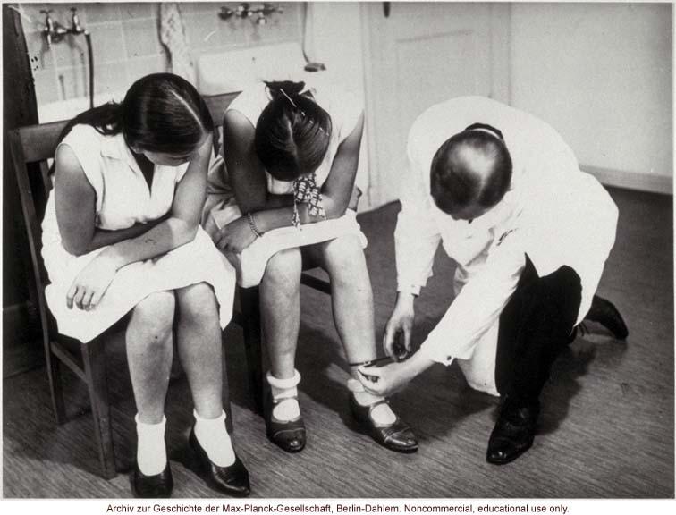 16-year-old female twins undergoing anthropometric study by Otmar Freiherr von Verschuer